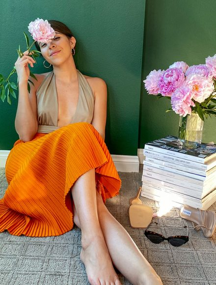 Orange skirt pair with a swimwear as a top
