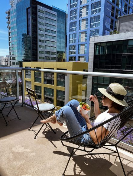 eating a poke in a balcony San Diego